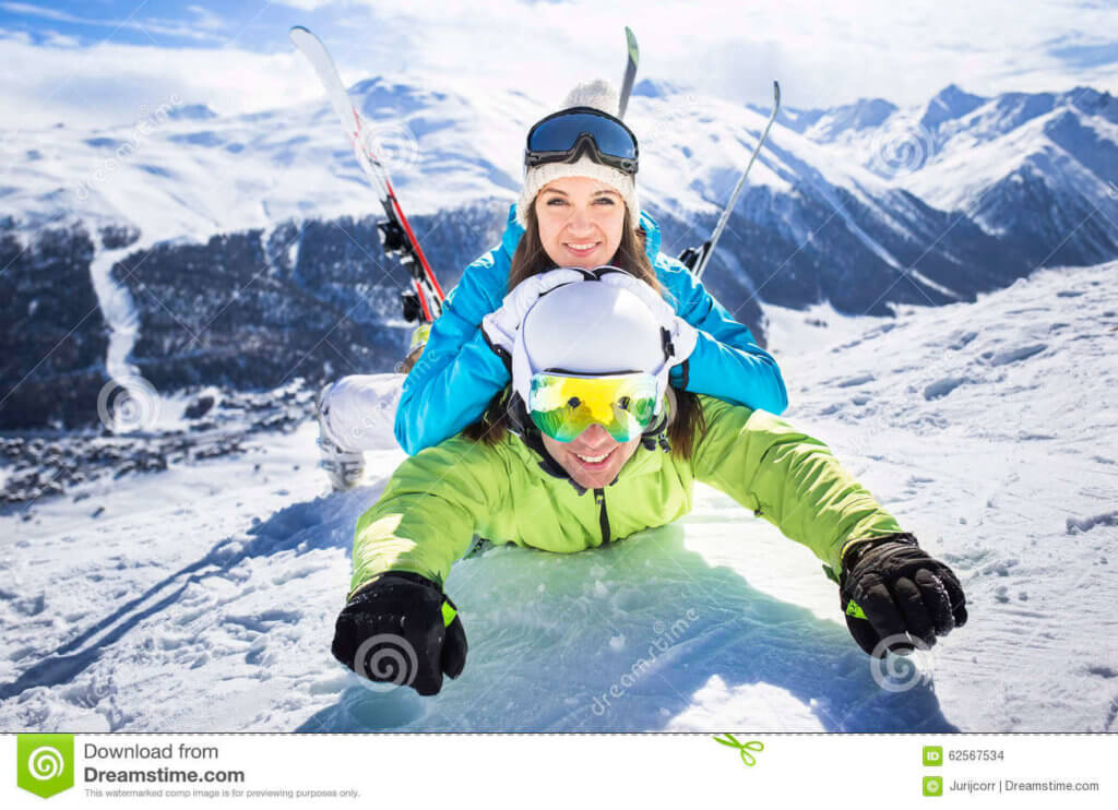 young-couple-funny-action-winter-ski-resort-female-male-friends-having-skiing-vacation-snow-slopes-european-alps-62567534
